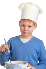 Boy in chef's hat with pan and ladle