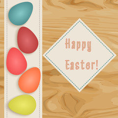 Colorful  postcard for Easter holidays. Eggs on wooden surface