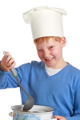 Red-haired boy in chef's hat with ladle and pan