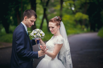 groom and bride in park