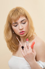 woman applying highlighting pen and blush