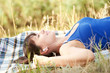 woman listening to music lying on the plaid