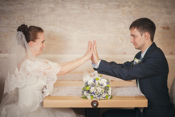 bride and groom sitting table