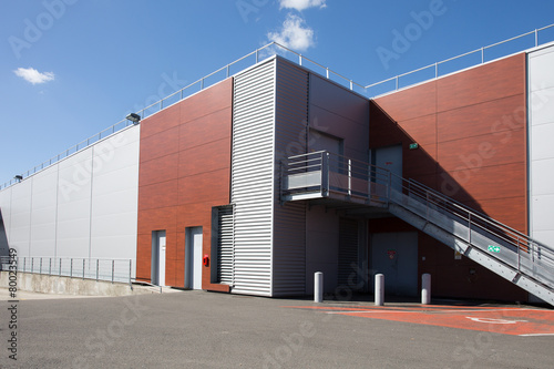 The exterior of a modern warehouse - 80023549