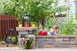 Cute little girl playing on a garden wall