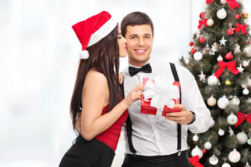 Woman getting a Christmas present from boyfriend