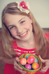 girl with a basket full of easter eggs