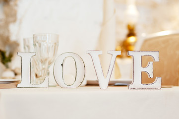 Love sign on table. Decor in restaurant