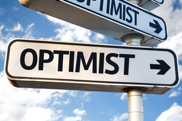 Optimist direction sign on sky background