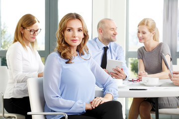 Attractive business woman at meeting