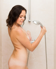 Beauty girl washing with shower