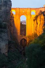Medieval bridge in evening. Ronda