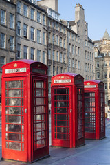 Old red telephone booths Royal mile street in Edinburgh
