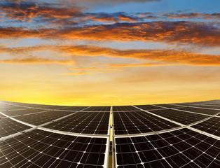 Solar energy panels against sunset sky. Green energy.