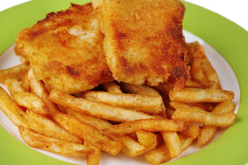 Breaded fried fish fillet and potatoes on plate background