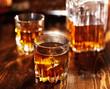 Leinwandbild Motiv whiskey in glass with decanter in background