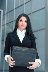 Young business woman in front of an office building