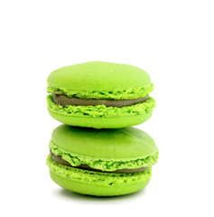 colorful macaroons over white background