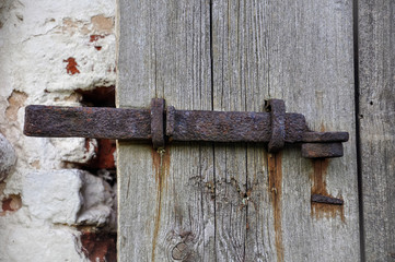 Part of the antique wooden door and pivot hook