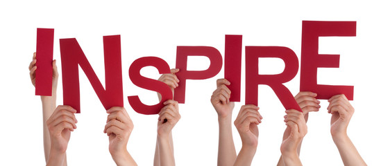 Many People Hands Holding Red Word Inspire
