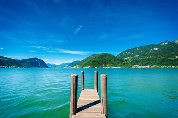 Pier on lake with mountains