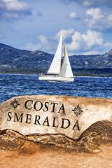 Yacht sailing in open azure sea near the Sardinia island, Italy
