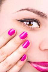 Female eye and manicure