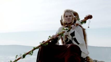 Female Druid sitting on mountain