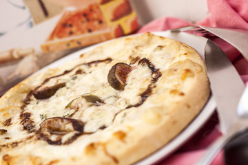 Pizza cheese and figs.