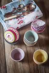 Colorful cupcake wrappers over a wooden table