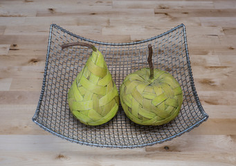 Fruits made from bast in the silver basket