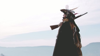 Female Hunter standing on mountain