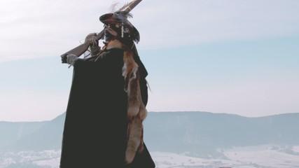 Female Hunter loading rifle on mountain
