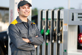 Smiling gas station worker - 80032757