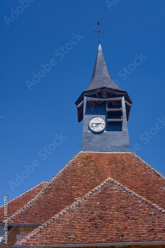 Tower with clock in medieval parish church in Champagne, France.