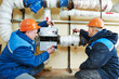 heating engineer repairman in boiler room - 80033984
