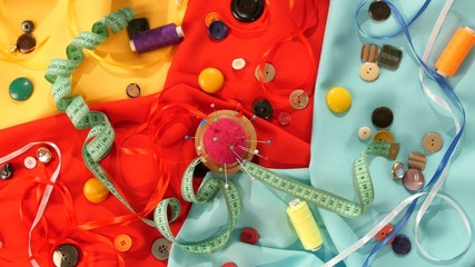 Tailor spools of colorful thread, buttons, pincushion, measuring