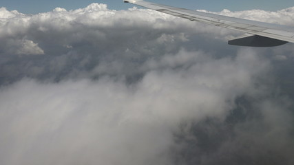Airplane Outside View From Window Through Clouds