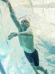 76 year old swimmer, underwater view