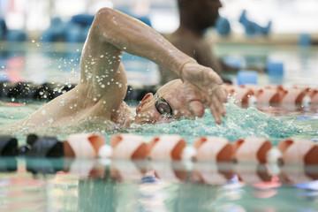 senior man swimming laps