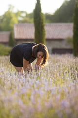 woman smelling lavender blooms