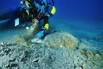 Italy, Mediterranean Sea, diver and a Roman amphora  - FILM SCAN