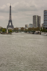 Eiffel tower and small statue of Liberty - Paris.
