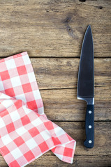 Cutting board and knife with red  tablecloth