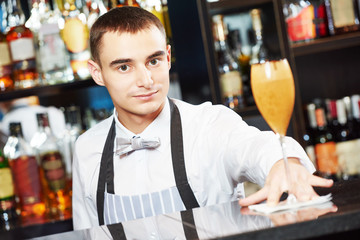 Bartender with coctail at bar