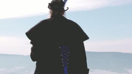 Female adventuerer standing on mountain