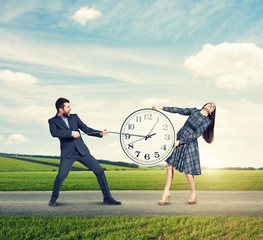 couple with clock at outdoor