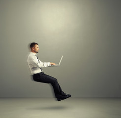 man working with laptop and flying