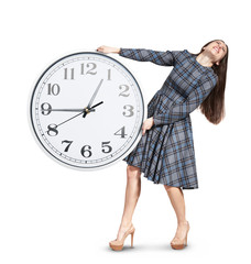 woman holding heavy white clock