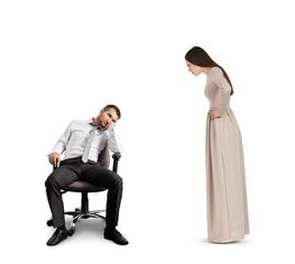 woman looking at tired man